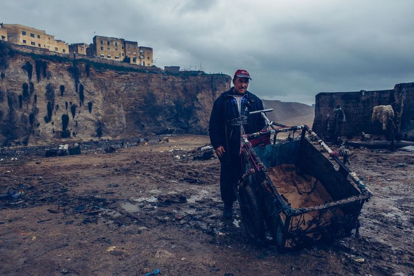 Worker on a landfill outside of the moroccan city Fes. Reportage Documentary Photography Documentary Photojournalism Hardwork Fes Portrait Maroc EyeEm Best Shots Morocco View Dirt Work Worker Dark Waste City One Person Real People Sky The Photojournalist - 2018 EyeEm Awards Standing Cloud - Sky Men Day Transportation The Portraitist - 2018 EyeEm Awards