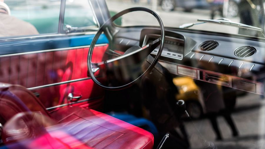Mode Of Transportation Car Transportation Motor Vehicle Retro Styled Land Vehicle Steering Wheel Indoors  Musical Instrument Music Travel Car Interior Glass - Material Day Red Arts Culture And Entertainment Close-up No People Vehicle Interior Analogue Sound