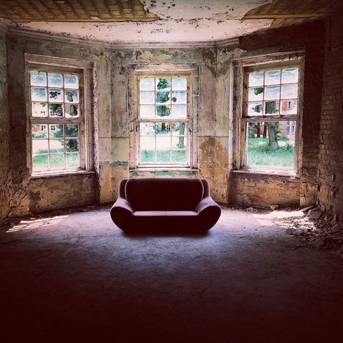 Empty sofa in abandoned building