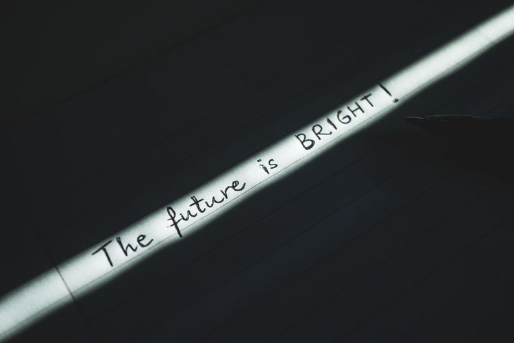 The future is bright. EyeEm Best Shots EyeEm Selects Life Motivation Thinking Backgrounds Black Background Close-up Communication Enjoying Life Expression Full Frame Hand Writing Light And Shadow Optimism Optimistic Pen Photography Positive Emotion Positive Vibes Striped Technology Text Western Script Wireless Technology