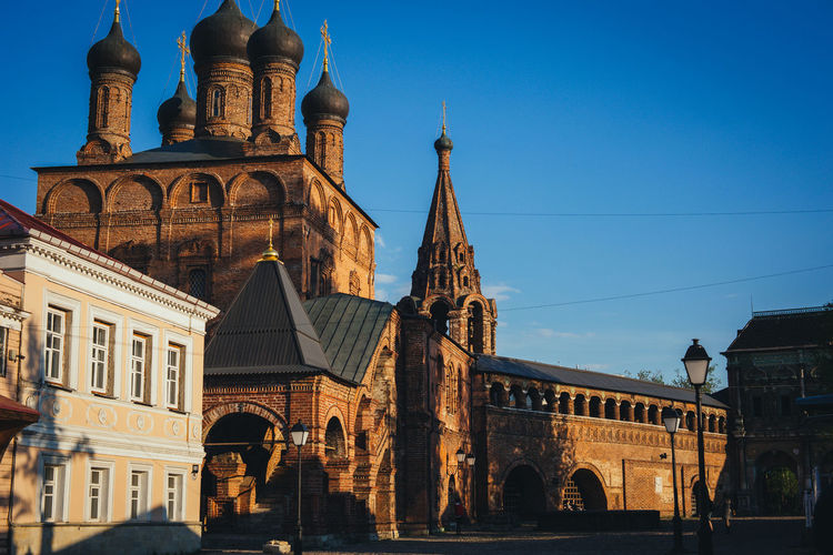 Krutitskoye Podvor'ye Church Arch Architecture Belief Blue Building Building Exterior Built Structure City Clear Sky Day History Low Angle View Nature No People Outdoors Place Of Worship Religion Sky Spire  Spirituality Temple The Past Travel Destinations