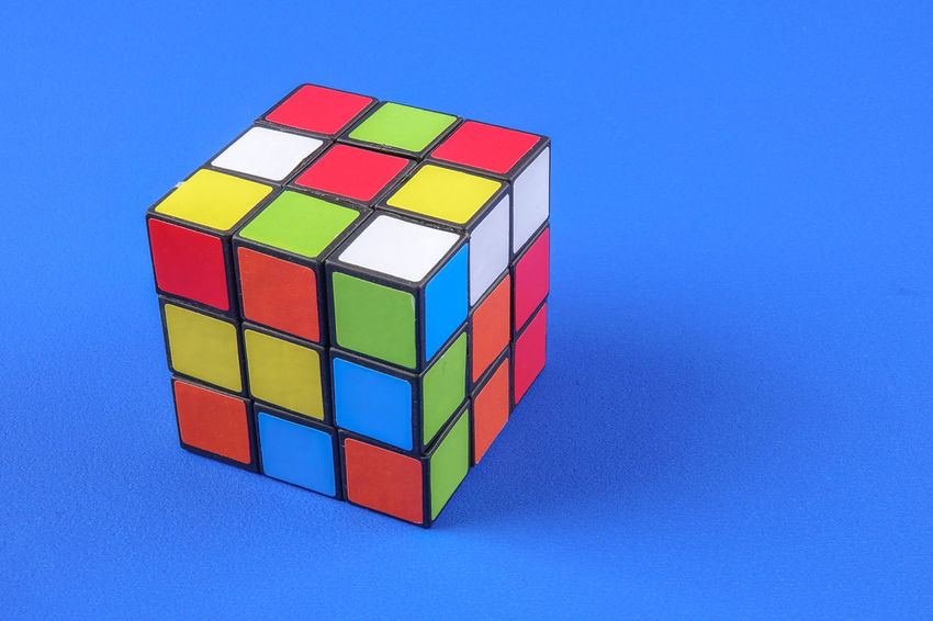 RUBIK'S CUBE , CREATIVITY TOY Creativity Rubik Cube Block Blue Blue Background Circle Close-up Colored Background Copy Space Cube Shape Design Geometric Shape Indoors  Intelligence Multi Colored No People Rubik Shape Still Life Studio Shot Toy Toy Block Wood - Material
