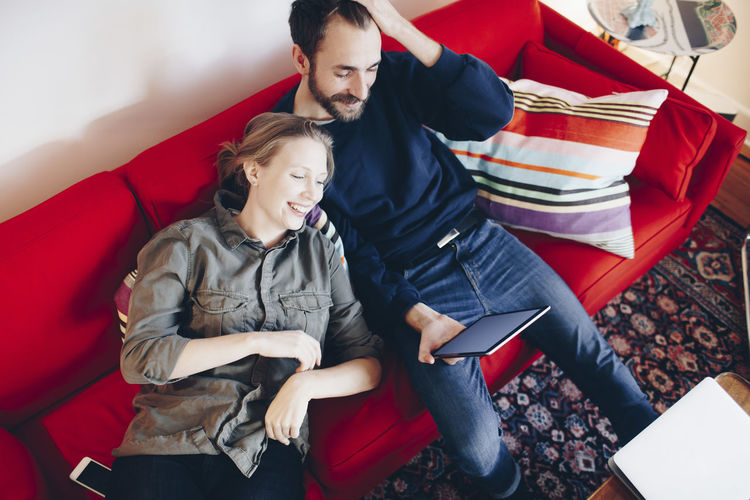 High angle view of young couple sitting on table
