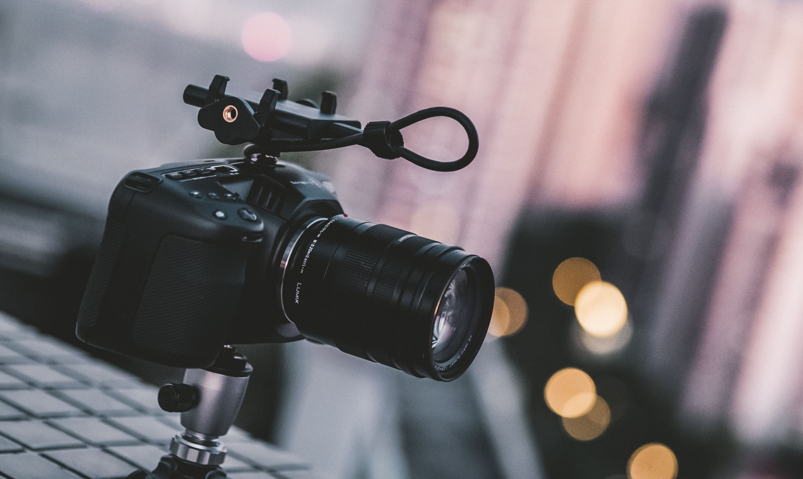 technology, focus on foreground, camera - photographic equipment, photography themes, close-up, photographic equipment, camera, digital camera, no people, arts culture and entertainment, lens - optical instrument, tripod, communication, day, black color, equipment, film industry, microphone, cable, input device, slr camera