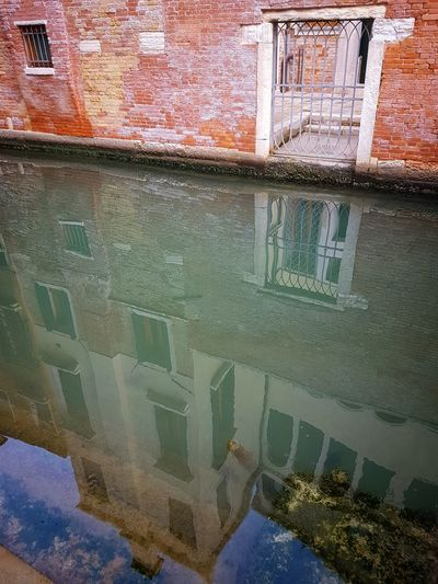 Window Water Day Outdoors Architecture Travel Destinations Reflections And Shadows Water Canals Building Exterior City Gates Iron Work Red Brick Walls Venezia Venice The One And Only