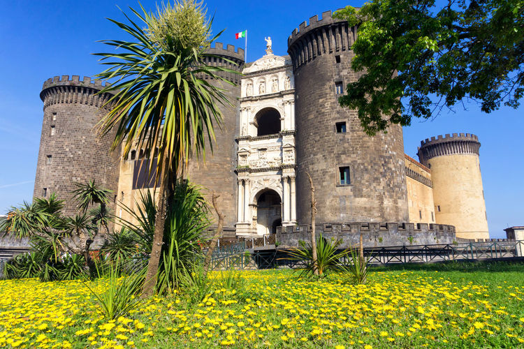 Beautiful view of the Castel Nuovo in Naples, Italy Ancient Castel Nuovo Naples Castle European  Maschio Angioino Naples Naples, Italy View Architecture Building Built Structure Castel Europe Fortress Historic History Italy Landmark Medieval Monument Nuovo Palm Tree Town Travel Travel Destinations
