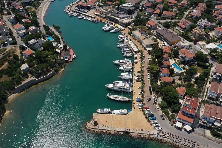 High angle view of marina and buildings in city