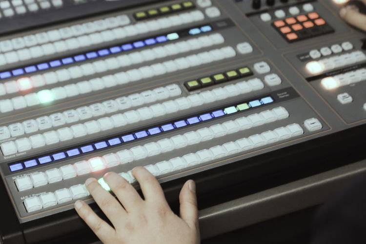 Cropped hands mixing music in recording studio