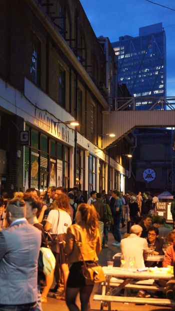 A night out by The Loading Bay Gallery, London Rustic Brick Wall Cozy Dusk Night Beer Clubbing London Atmosphere Yellow Orange Lights Crowd Skyscraper Alley Alleyway Friends Calm Loading Bay Gallery Night Illuminated People Travel Destinations City Vacations Cityscape Lifestyles Architecture