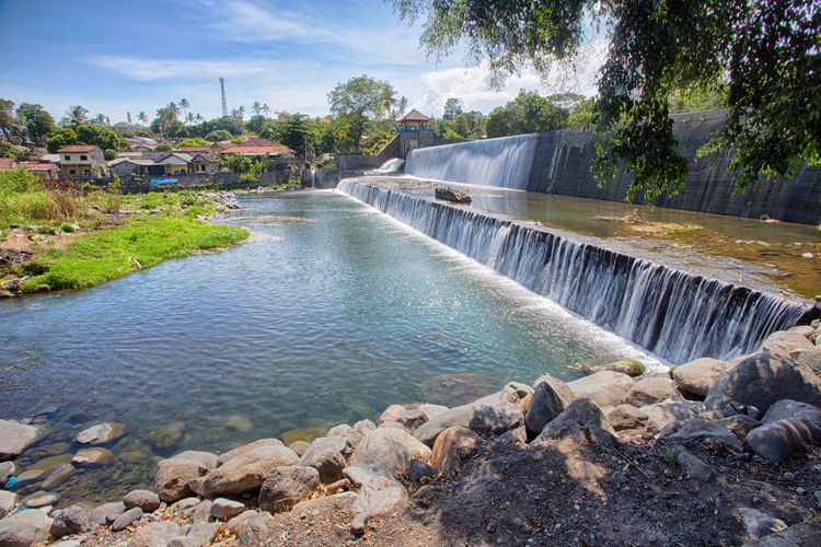 View of Tukad Unda Dam in Klungkung, Bali. Architecture ASIA Bali Beauty In Nature Bridge - Man Made Structure Built Structure Cloud Day Flowing Flowing Water INDONESIA Klungkung Nature No People Outdoors River Rock - Object Scenics Sky Stone - Object Tranquil Scene Tranquility Tree Tukadunda Water