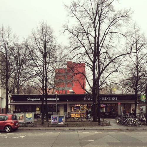Architecture Bagdad Berlin Photography Kreuzberg Schlesisches Tor Trees Abstract Architecture Bare Tree Berliner Ansichten Berlinstagram Branch Building Exterior Built Structure Cafe City Land Vehicle Minimalism Nature No People Outdoors Sky Skyporn Transportation Tree