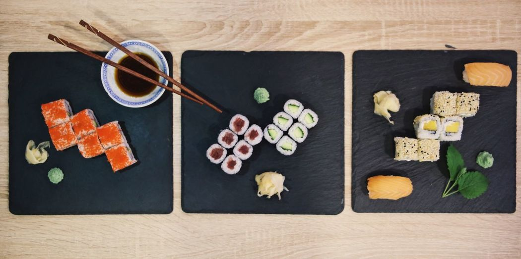 Sushi variety Indoors  Directly Above Food Freshness Healthy Eating Wellbeing Variation Sushi Ready-to-eat Cutting Board Chopsticks Rice Close-up