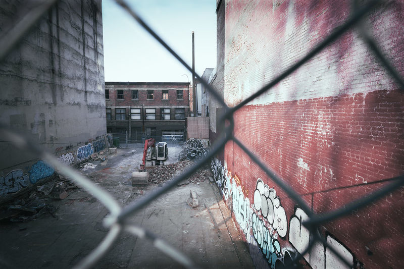 View of building through chainlink fence