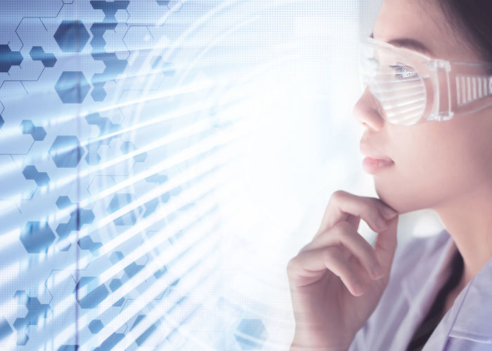 Digital composite image of scientist looking at molecular structure in laboratory