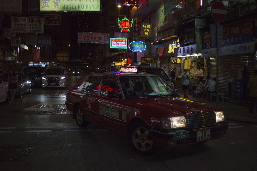 Hong Kong HongKong Architecture Building Exterior Built Structure Car City City Life City Street Communication Illuminated Incidental People Land Vehicle Mode Of Transportation Motion Motor Vehicle Night on the move Road Sign Street Transportation