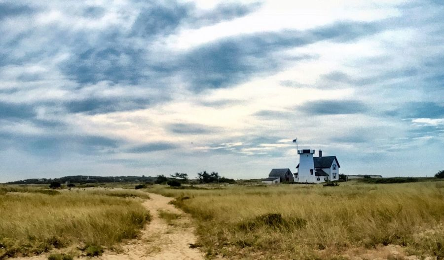Beauty In Nature Beach Early Morning Peaceful Remote Lighthouse Cloud - Sky Mode Of Transport Grass Sky Field Land Vehicle Landscape Nature Outdoors No People