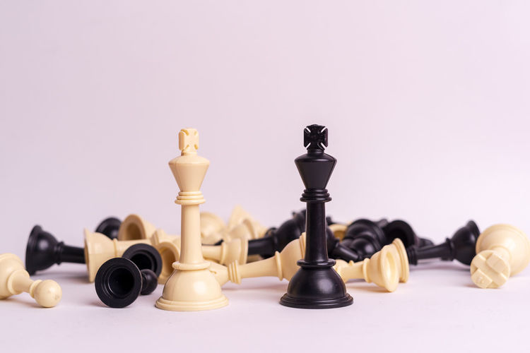 Chess set on white background. Indoors  Chess Game Competition Queen King - Royal Person King Army Strategy Leader Leadership Decisions Board Game Leisure Games Chess Piece Studio Shot King - Chess Piece Relaxation Large Group Of Objects No People Arts Culture And Entertainment Close-up Leisure Activity Chess Board Copy Space Colored Background Still Life Pawn - Chess Piece Queen - Chess Piece