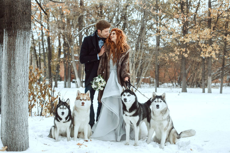 EyeEm Best Shots EyeEm Selects EyeEmNewHere Animal Themes Beautiful Woman Beauty In Nature Cold Temperature Day Dog Domestic Animals Eye4photography  Front View Full Length Lifestyles Nature Outdoors Pets Portrait Real People Snow Tree Warm Clothing Winter Young Adult Young Women