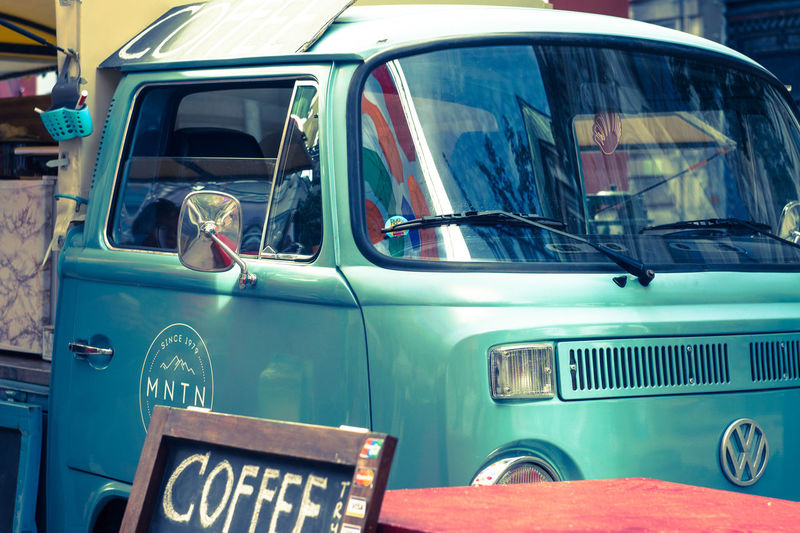 Small foodtruck outdoors. Coffee Business Close-up Foodtruck Glass - Material Hippie Land Vehicle Metal Mode Of Transportation Motor Vehicle Multivan No People Old Reflection Retro Styled Stationary Transportation Truck Turquoise Colored Van Vintage Car Volkswagen Windshield