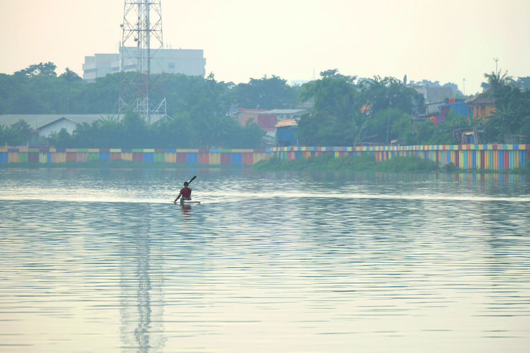 Do rowing in lake Sunter, North Jakarta. Water Waterfront Real People Nature Sport Reflection One Person Lake Beauty In Nature Outdoors