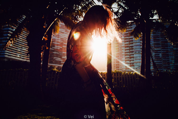 Night One Person Adults Only Adult People One Man Only Only Men Outdoors Window Standing City Building Exterior PortraitOnly Women City One Young Woman Only One Woman Only Illuminated Young Adult Cityscape Sky