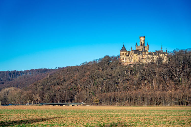 Marienburg Castle in the Morning Built Structure Building Exterior Architecture Sky Tree Plant Building History The Past Travel Destinations Clear Sky Nature No People Landscape Castle Land Tower Outdoors Government Niedersachsen Germany Nordstemmen Marienburg Welfen