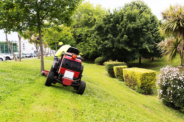 sewer line drainage by professional workers with hose and pressurized water of service truck Mower Lawnmower Gardener Grass Mover Lawn Service Utility Backyard Golf Summer Spring Work Equipment Vehicle Care Cut Electric Home Machine Green Color Gardening