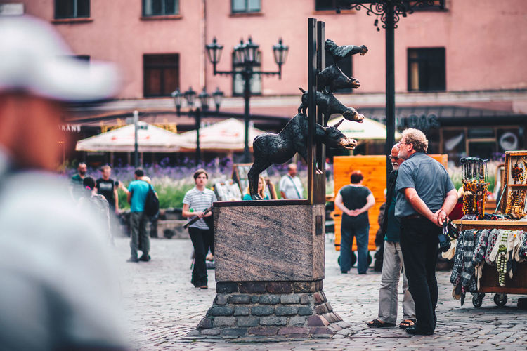 Statue of The Bremen Town Musicians Bremen Bremen Town Musicians Architecture Artist Building Exterior Built Structure City Day Large Group Of People Men Musicians Outdoors People Real People Sculpture Skill  Statue The Street Photographer - 2018 EyeEm Awards