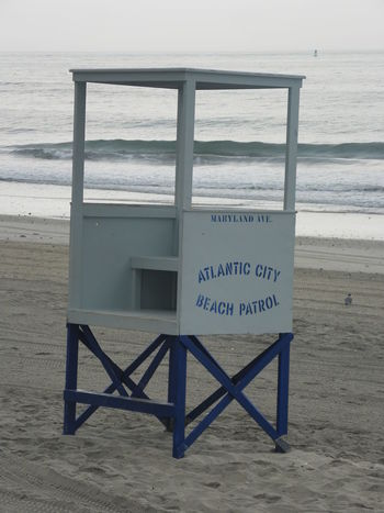 Absence Alantic Ocean Arrow Symbol Atlantic City Beach Beach Day Beach Patrol Capital Letter Communication Day Direction Guidance Information Information Sign Life Guard Stand Non-western Script Road Sign Safety Sand Sign Text Wall Warning Sign Western Script Window