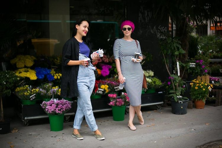 Female friends standing in front of flower shop
