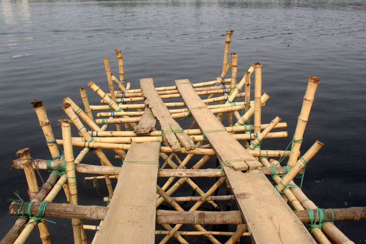 Wood - Material Water Nature No People Day Bamboo - Material High Angle View Lake Outdoors Wood Wooden Raft Bamboo Abandoned Focus On Foreground Wooden Post