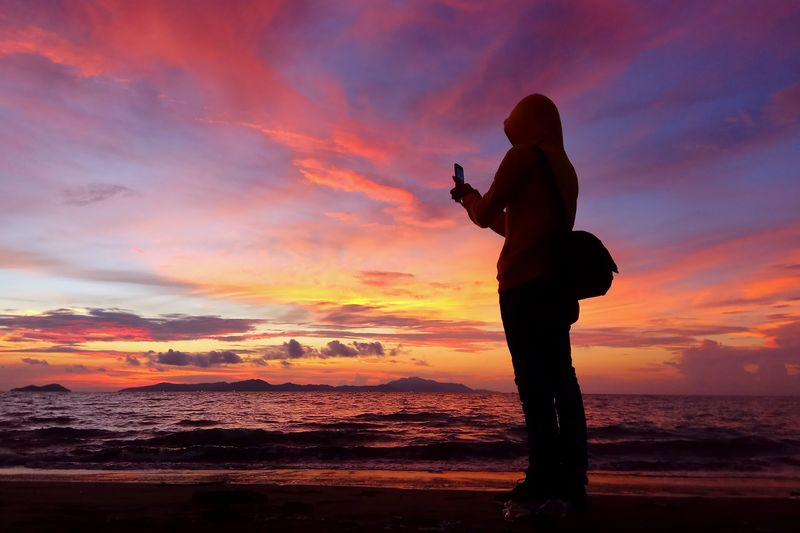 Aceh Culture Aceh INDONESIA Photography Photography Themes Sunset Beach Water Multi Colored Full Length Standing Sea Silhouette Photographing Atmospheric Mood Calm Shore Photographer Horizon Over Water Sky Only Tranquil Scene Romantic Sky Coast Photographic Equipment Tranquility Scenics Paparazzi Photographer
