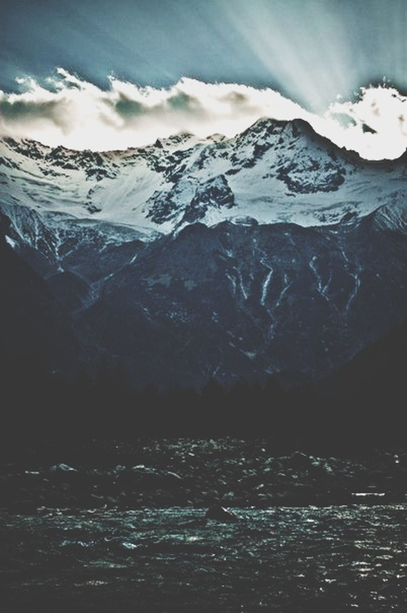 mountain, cold temperature, snow, winter, mountain range, snowcapped mountain, scenics, tranquil scene, beauty in nature, tranquility, season, sky, water, weather, nature, frozen, waterfront, lake, cloud - sky, idyllic