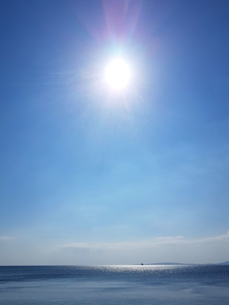 sea, sun, sunlight, water, beauty in nature, scenics, nature, sky, outdoors, tranquility, tranquil scene, day, horizon over water, no people, blue, clear sky