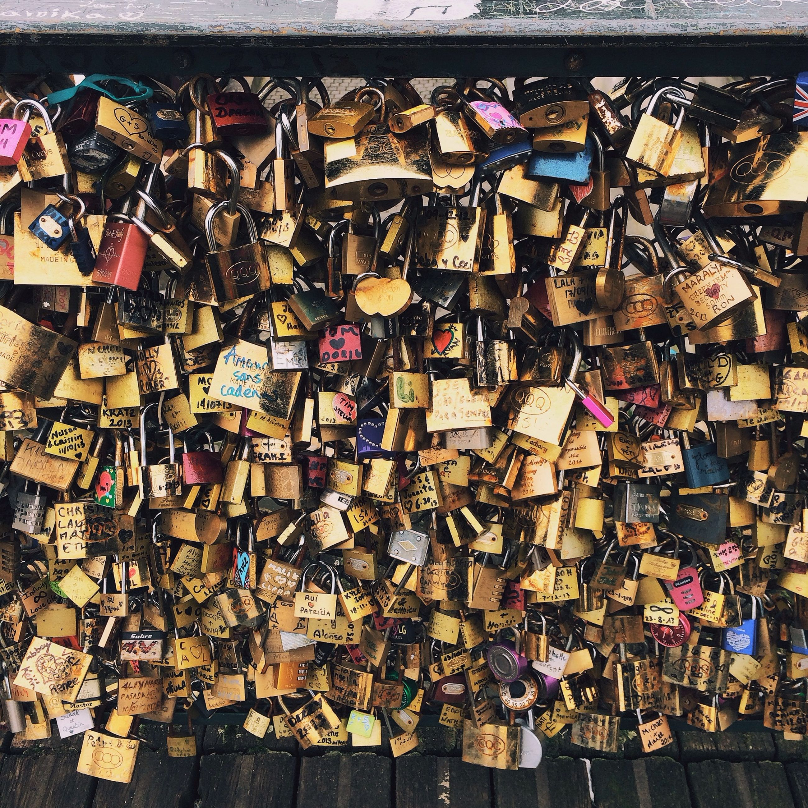 full frame, backgrounds, abundance, large group of objects, metal, wall - building feature, built structure, padlock, architecture, pattern, building exterior, protection, variation, metallic, outdoors, day, security, in a row, high angle view, hanging