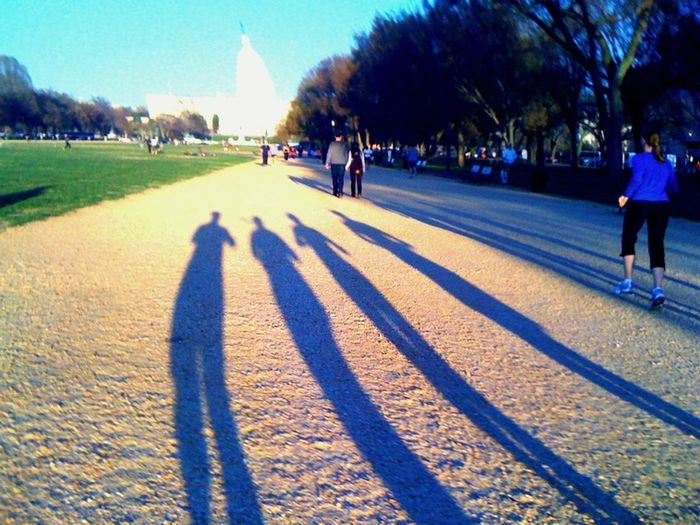 During a 5.5-mile run around the Mall in DC in March, my shadow and those of my three friends reach for the Capitol.