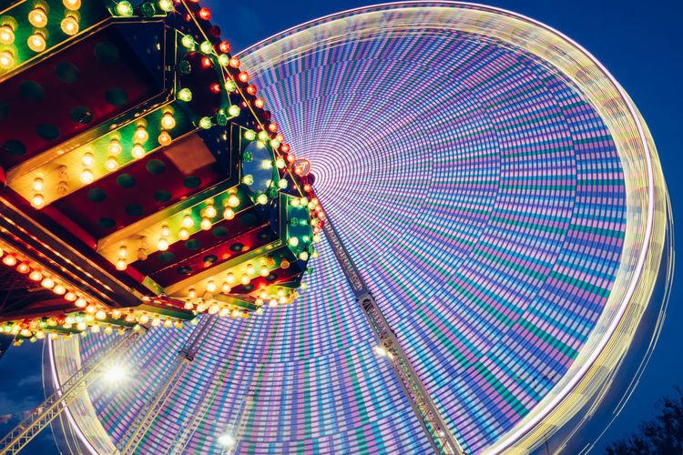 Blurred Motion Of Illuminated Ferries Wheel At Night