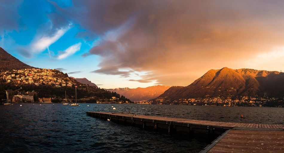 Lake como at Golden Hour. Italy Lake Como Lake Como Photography Photographer Yellow Blue Warm Cool Contrast Panorama EyeEm Selects Mountain Sunset Mountain Range Landscape Dramatic Sky Beauty In Nature Snow Outdoors Nature Water Day First Eyeem Photo