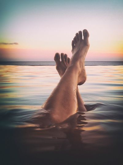 Feet up in the infinity pool in Cabo San Lucas, Mexico Water Lifestyles Relaxation One Person Barefoot Leisure Activity Sunset Human Foot Sea Human Leg Horizon Over Water Vacations Real People Low Section Sky Men Human Body Part Outdoors Nature Beach Vacations Relaxing Swimming Swimming Pool Mexico Lieblingsteil Live For The Story