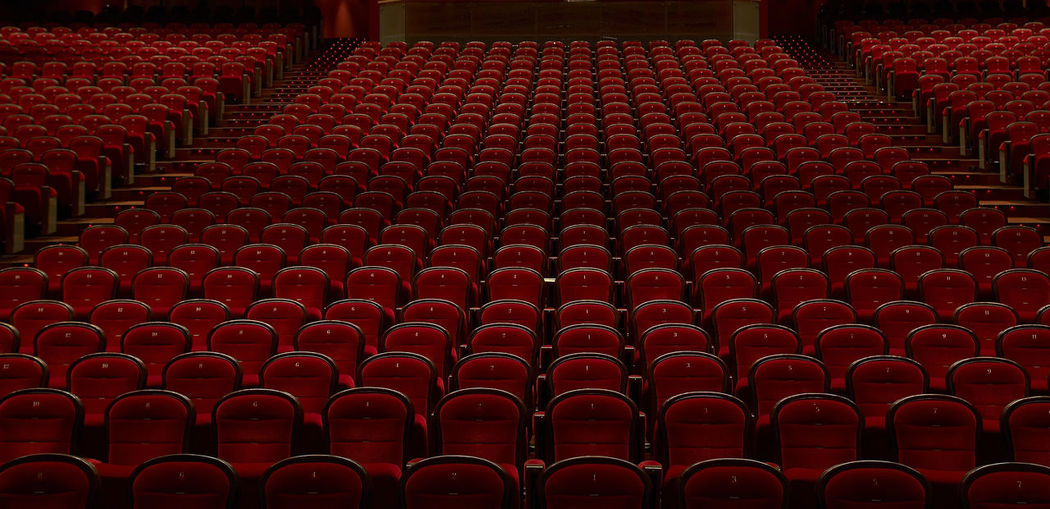 theater Absence Abundance Arrangement Arts Culture And Entertainment Backgrounds Chair Empty Film Industry Full Frame In A Row Indoors  Large Group Of Objects Movie Theater No People Order Pattern Red Repetition Seat Side By Side Stage