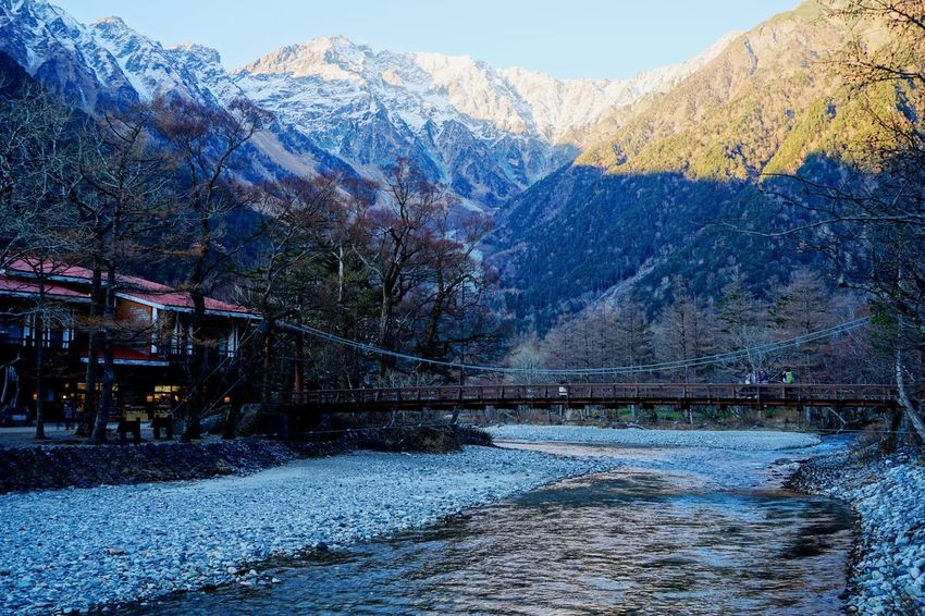 "Seeing The Sights Here is called "" Japanese Yosemite Valley "" So famous place. EyeEm Nature Lover Mountain View BrigeWood Wildlife & Nature Landmark EyeEm Best Shots - Landscape International Landmark Blue Sky Snow River Collection Beautufulwiew Mountain Hiking River Walk Taking Photo at Kamikochi in Nagano Prefecture Japan 11月初めの上高地です。 Adapted To The City"