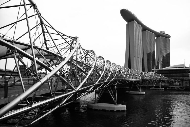 Bridges Marina Bay Sands Architecture Blackandwhite Photography Bridge Bridge - Man Made Structure Built Structure Clear Sky Connection Day Lines And Shapes Luxury Nature No People Outdoors River Sky Steel Tall - High Transportation Travel Travel Destinations Water