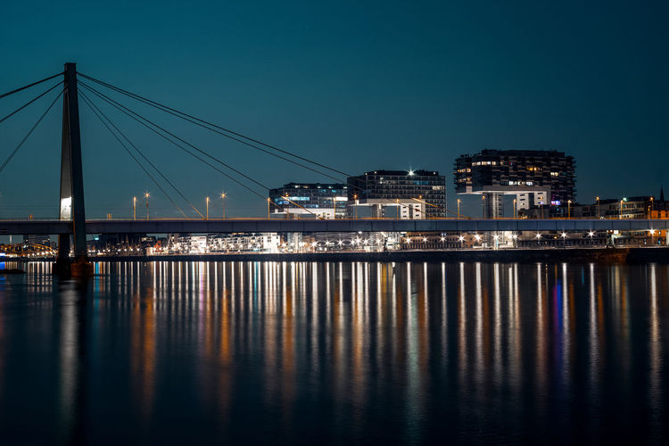 The crane houses and the severinsbridge in cologne at night.