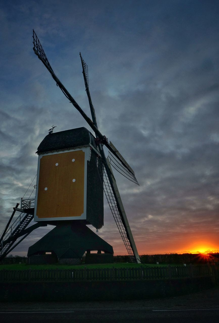 wind power, windmill, alternative energy, wind turbine, renewable energy, environmental conservation, fuel and power generation, traditional windmill, cloud - sky, sky, sunset, field, industrial windmill, rural scene, no people, outdoors, low angle view, built structure, technology, nature, day, architecture, nautical vessel, building exterior, beauty in nature