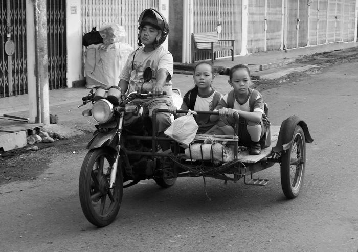 the road is long... Aceh HUMANITY Real People School Casual Clothing Togetherness Group Of People Land Vehicle People Street Sitting City Mode Of Transportation Full Length Men Child Transportation Childhood Asian Girl Asian Culture Bikers