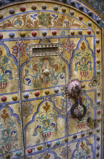 detail of an old multicolored wooden door with letterbox and door bell 1000 And 1 Night Door Bell Architecture Built Structure Close-up Door Full Frame Letterbox Maroccan Architecture Multicolored Multicolored Wood No People