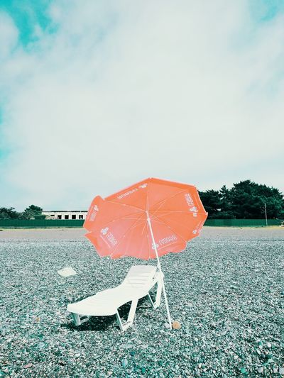 The Week on EyeEm Absence Beach Cloud - Sky Day Land Nature No People Orange Color Outdoors Plant Protection Scenics - Nature Security Sky Tranquil Scene Tranquility Umbrella Water