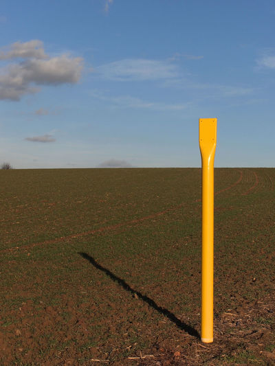 Yellow metal post, sign of a pipeline Outdoors Non-urban Scene Horizon Over Land Horizon Grass Plant Beauty In Nature Day Scenics - Nature No People Yellow Tranquil Scene Nature Cloud - Sky Field Landscape Sky Environment Land Pipeline Sign Pole Post Metal Post Oil Pipeline