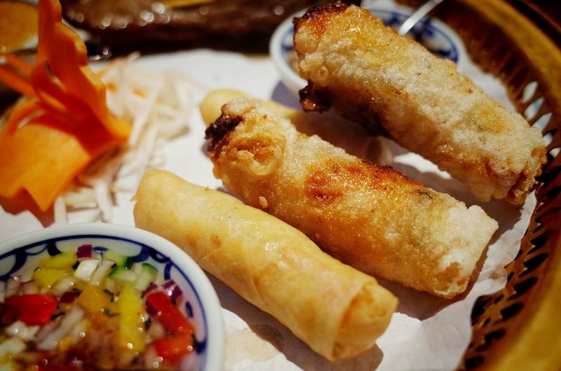 Close-up of spring rolls served in plate