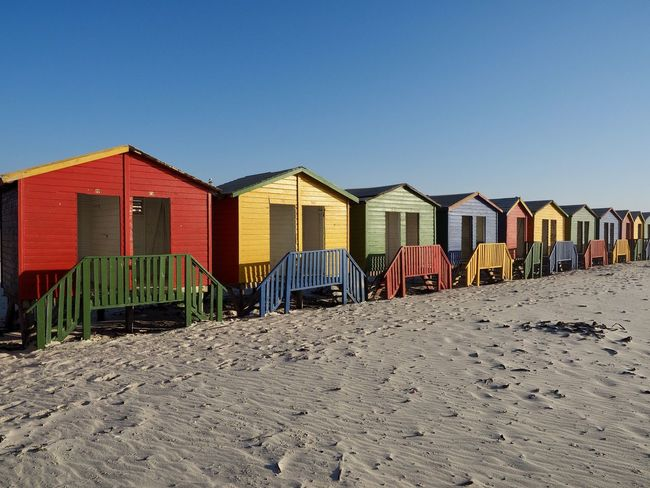 Colors - Muizenberg, SA Architecture Beach Beach Volleyball Blue Building Exterior Built Structure Clear Sky Day In A Row Marram Grass Multi Colored Nature No People Outdoors Sand Sand Dune Shore Sky Summer Sunlight Vacations